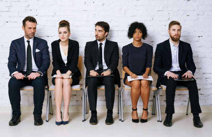 Stressed business people waiting for job interview